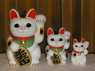 Porte bonheur le chat japonais bonheur de lire - Porte bonheur chinois chat ...